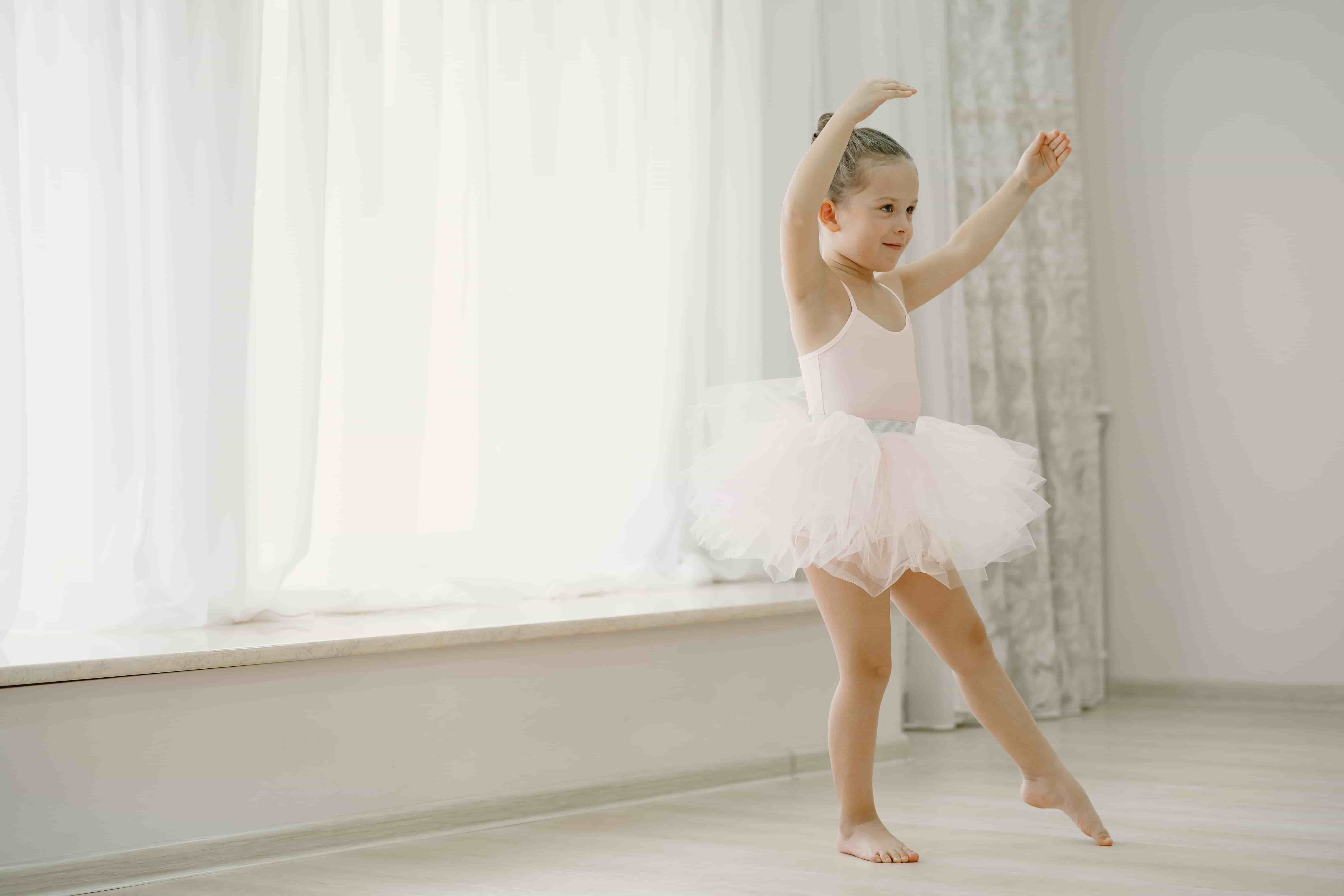 cute-little-ballerinas-pink-ballet-costume-child-pointe-shoes-is-dancing-room-kid-dance-class-min